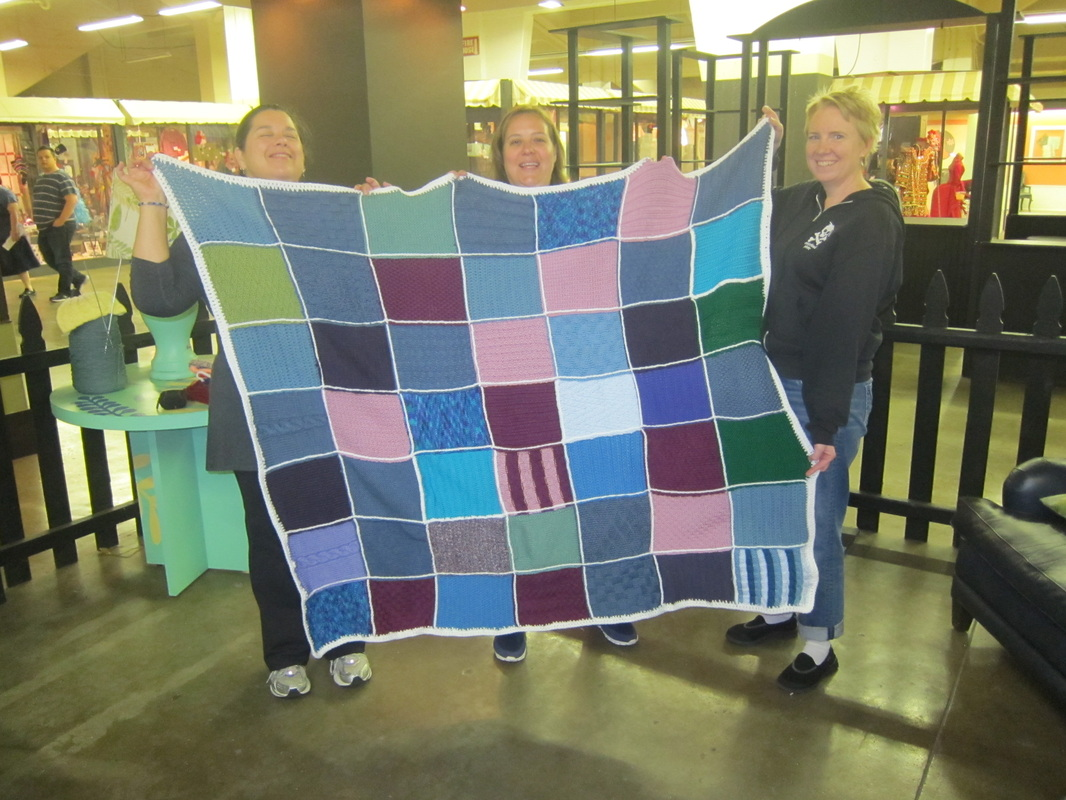Jenn Sarah And Tammy Hold Our Finished Charity Blanket For Warm Up America Photo Taken In Tapestry Area Of La County Fair Sept 2017